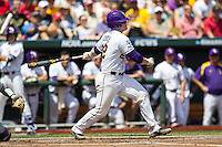 LSU Tigers catcher Kade Scivicque (22) follows through on his swing against the TCU Horned Frogs in the NCAA College World Series on June 14, 2015 at TD Ameritrade Park in Omaha, Nebraska. TCU defeated LSU 10-3. (Andrew Woolley/Four Seam Images)