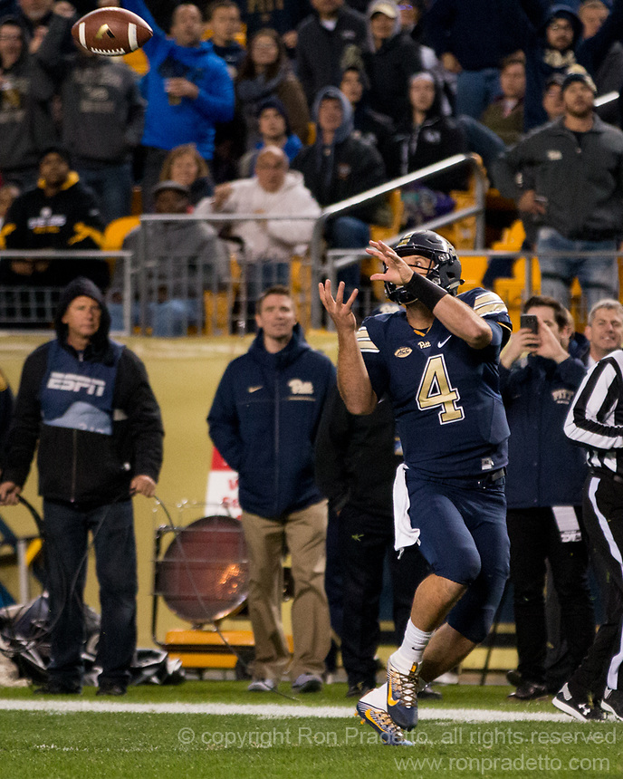 Pitt quarterback Nathan Peterman catches a pass. The Virginia Tech Hokies defeated the Pitt Panthers 39-36 on October 27, 2016 at Heinz Field in Pittsburgh, Pennsylvania.