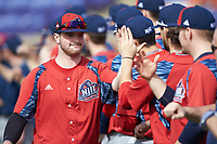 Bryan Haberstroh (7) of the NJIT Highlanders bumps fists with teammates during player introductions prior to the game against the High Point Panthers at Williard Stadium on February 18, 2017 in High Point, North Carolina. The Panthers defeated the Highlanders 11-0 in game one of a double-header. (Brian Westerholt/Four Seam Images)