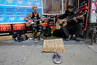 """Toronto (ON) CANADA,  April , 2008-<br /> Street Musicians playing (Social Distorsion's version of ) Johhny Cash """"Ring of Fire' on Queen street."""
