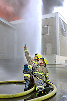 Roseville firefighters battle a fire behind a Ross store in Roseville Square, Roseville, CA, Tuesday, July 11, 2006. (The Press-Tribune photo /Pico van Houtryve)