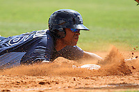 Tampa Bay Rays Leandro Caminero #76 slides into third during a spring training game against the Baltimore Orioles at the Buck O'Neil Complex on March 21, 2012 in Sarasota, Florida.  (Mike Janes/Four Seam Images)