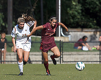 Virginia Tech defender Danielle King (8) works to clear ball as Boston College defender McKenzie Meehan (22) pressures.Virginia Tech (maroon) defeated Boston College (white), 1-0, at Newton Soccer Field, on September 22, 2013.