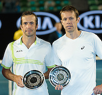 January 30, 2016: Daniel Nestor of Canada and Radek Stepanek of Czech Republic receive their runners' up trophy for the Men's Doubles against Jamie Murray of United Kingdom and Bruno Soares of Brazil on day thirteen of the 2016 Australian Open Grand Slam tennis tournament at Melbourne Park in Melbourne, Australia. Murray and Soares won 26 64 75. Photo Sydney Low