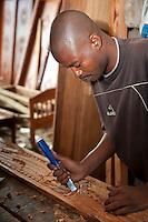 Zanzibar, Tanzania.  Wood Carver at Work.