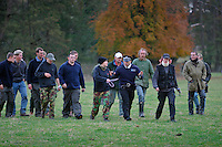 Suffolk, England, 01/11/2003..The Essex & Suffolk Fox-hounds on the first day of what may be the last legal hunting season in the UK, as Parliament moves to ban hunting with dogs..Hunt stewards watch as police seize anti-hunt demonstrators from the Hunt Saboteurs Association, who use bottles of scent to confuse the dogs and try to disrupt the hunt, confronting hunters and police.
