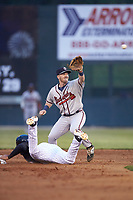Rome Braves second baseman Greg Cullen (18) reaches for a high throw as Amado Nunez (18) of the Kannapolis Intimidators dives back towards second base at Kannapolis Intimidators Stadium on April 4, 2019 in Kannapolis, North Carolina.  The Braves defeated the Intimidators 9-1. (Brian Westerholt/Four Seam Images)