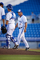 Dunedin Blue Jays pitching coach Mark Riggins (29) walks to the mound for a visit during a game against the St. Lucie Mets on April 19, 2017 at Florida Auto Exchange Stadium in Dunedin, Florida.  Dunedin defeated St. Lucie 9-1.  (Mike Janes/Four Seam Images)