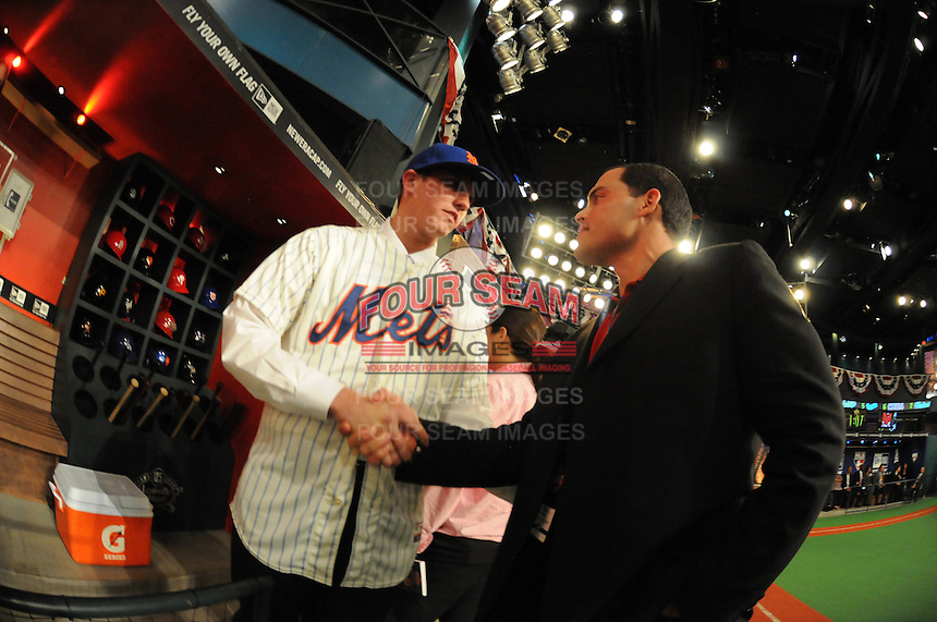 Shortstop Gavin Cecchini (Barbe H.S.) the number tweleve overall pick to the New York Mets with former All Star catcher Ivan Rodriguez during the MLB Draft on Monday June 04,2012 at Studio 42 in Secaucus, NJ.   (Tomasso DeRosa / Four Seam Images)