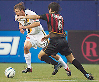 Sasha Victorine of the Galaxy looks to get around Juan Forchetti of the MetroStars. The LA Galaxy lost to the NY/NJ MetroStars 1-0 on 6/21/03 at Giant's Stadium, NJ..