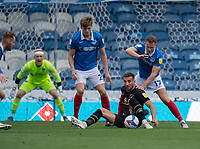 Portsmouth's Bryn Morris (right) battles for possession with Milton Keynes Dons' Baily Cargill (centre)<br /> <br /> Photographer David Horton/CameraSport<br /> <br /> The EFL Sky Bet League One - Portsmouth v Milton Keynes Dons - Saturday 10th October 2020 - Fratton Park - Portsmouth<br /> <br /> World Copyright © 2020 CameraSport. All rights reserved. 43 Linden Ave. Countesthorpe. Leicester. England. LE8 5PG - Tel: +44 (0) 116 277 4147 - admin@camerasport.com - www.camerasport.com