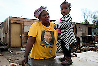 The African National Congress is still the dominant political power in South Africa. Coming to power under Nelson Mandela in 1994, it still holds promise to many poor, blacks in the townships of South African. The picture on this mother's T-shirt is of the current president, Jacob Zuma.