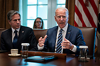 United States President Joe Biden speaks as US Secretary of State Antony Blinken, left, listens during a cabinet meeting at the White House in Washington, D.C., U.S., on Tuesday, July 20, 2021. Biden administration officials say they're starting to see signs of relief for the global semiconductor supply shortage, including commitments from manufacturers to make more automotive-grade chips for car companies. <br /> CAP/MPI/RS<br /> ©RS/MPI/Capital Pictures
