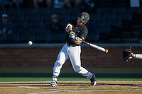 Ben Breazeale (9) of the Wake Forest Demon Deacons swings at the baseball during the game against the Florida State Seminoles at David F. Couch Ballpark on April 16, 2016 in Winston-Salem, North Carolina.  The Seminoles defeated the Demon Deacons 13-8.  (Brian Westerholt/Four Seam Images)