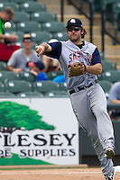 Colorado Springs Sky Sox third baseman Ryan Wheeler (19) makes a throw to first base against the Round Rock Express in the Pacific Coast League baseball game on May 19, 2013 at the Dell Diamond in Round Rock, Texas. Colorado Springs defeated Round Rock 3-1 in 10 innings. (Andrew Woolley/Four Seam Images).
