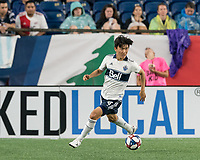 FOXBOROUGH, MA - JULY 18: Hwang In-Beom #4 looks to pass during a game between Vancouver Whitecaps and New England Revolution at Gillette Stadium on July 18, 2019 in Foxborough, Massachusetts.
