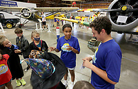 Camp counselors Regan McIntosh and John Sheeley discuss play ideas Friday, July 16, 2021, with their group during Drama Camp at the Arkansas Air and Military Museum in Fayetteville. The weeklong camp, presented by the city of Fayetteville Parks and Recreation in partnership with Pilot Arts, was attended by students ages 5-12 years old that learned to act, write and perform on stage. The camp was moved to the museum Friday because of the rain. Check out nwaonline.com/210717Daily/ and nwadg.com/photos for a photo gallery.(NWA Democrat-Gazette/David Gottschalk)