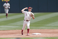 Arkansas infielder Robert Moore (1) throws, Saturday, April 3, 2021 during the third inning of a baseball game at Baum-Walker Stadium in Fayetteville. Check out nwaonline.com/210404Daily/ for today's photo gallery. <br /> (NWA Democrat-Gazette/Charlie Kaijo)