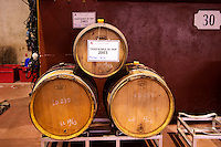 Three wooden barrels stacked in a pyramid. Sign with Chateauneuf du Pape rouge bio (organic) 2003. Domaine M Chapoutier, Tain l'Hermitage, Drome Drôme, France Europe