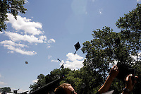 3 June 2011, Cambridge, MA - MIT Commencement..Graduating students toss their mortar board caps into the air after the 2011 commencement ceremony at the Massachusetts Institute of Technology....Photo by M. Scott Brauer for MIT News