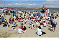 BNPS.co.uk (01202 558833)Pic: PhilYeomans/BNPS<br /> <br /> Mark Poulton performing his Punch and Judy show on Weymouth beach.<br /> <br /> Britain's seaside resorts could lose their last remaining Punch and Judy shows because of shocking abuse from onlookers.<br /> <br /> The iconic century old tradition is at risk of extinction as two of the country's last three shows are bombarded by insults from angry families refusing to donate just £2 to watch.<br /> <br /> Such donations are essential for the survival of the puppet shows, which rely entirely on public generosity to keep going.