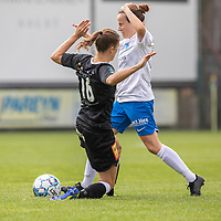 Anaelle Wiard (16) of Eendracht Aalst and Lorene Martin (6) of KRC Genk pictured during a female soccer game between Eendracht Aalst and KRC Genk on the third matchday of the 2021 - 2022 season of Belgian Scooore Womens Super League , Saturday 4 September 2021  in Aalst , Belgium . PHOTO SPORTPIX    KRISTOF DE MOOR