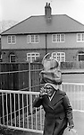 Wandsworth south London 1970s Black British woman returns home from the Arndale shopping Centre 1979. She is making some sort of gesture probably of dislike at me.
