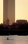 Rowing, Boston, Rower in single racing shell rows the Charles River past Nob Hill and Boston's highrise buildings at dawn, Charles River, Boston, Massachusetts, New England, USA, sunrise,