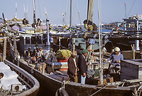 Dubai 1972, United Arab Emirates.  Crew of a Dhow Tied up along The Creek.