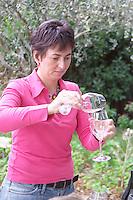 Christine Saurel owner vinifying glasses domaine montirius vacqueyras rhone france
