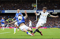 Pictured: Ben Davies of Swansea (R) has his shot blocked by an Everton player. Saturday 22 March 2014<br /> Re: Barclay's Premier League, Everton v Swansea City FC at Goodison Park, Liverpool, UK.