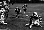 Bethel Park PA:  Defensive play with Gary Biro 81 and Mike Stewart 11 making the tackle on a Colts running back. Others in the photo; Ray Tedesco 61, Joe Barrett 75, Dan Hannigan 64, Jim Dingeldine 73, Dennis Franks 66, Glenn Eisaman.  The Bethel Park defense played very well in the 13-6 win at Chartiers Valley Stadium. The game went down to the last play of the game when Mike Stewart threw a 65 TD pass to Gary Biro 81.  The defensive unit was one of the best in Bethel Park history only allowing a little over 7 points a game.