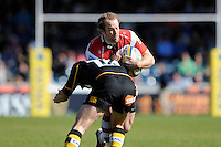 James Simpson-Daniel of Gloucester Rugby is tackled by Dom Waldouck of London Wasps during the Aviva Premiership match between London Wasps and Gloucester Rugby at Adams Park on Sunday 1st April 2012 (Photo by Rob Munro)