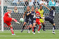 Sonia Bompastor #8 of the Washington Freedom takes a shot against the Los Angeles Sol during their inaugural match at Home Depot Center on March 29, 2009 in Carson, California.