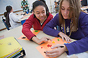 """Shamar Botley's seventh grade math class works with M&Ms to understand how one arrives at """"mean"""" numbers."""