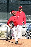 Aroldis Chapman, Cincinnati Reds pitcher in his first season after defecting from his native Cuba, pitches a bullpen session at the Reds training facility in Goodyear, AZ - 03/14/2010. Chapman is observed by Reds pitching coach Bryan Price..Photo by:  Bill Mitchell/Four Seam Images.