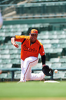 GCL Orioles first baseman Carlos Diaz (14) stretches for a throw during a game against the GCL Twins on August 11, 2016 at the Ed Smith Stadium in Sarasota, Florida.  GCL Twins defeated GCL Orioles 4-3.  (Mike Janes/Four Seam Images)
