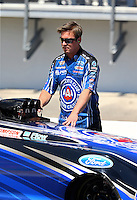 Mar 14, 2014; Gainesville, FL, USA; Mike Neff , crew chief for NHRA funny car driver Robert Hight during qualifying for the Gatornationals at Gainesville Raceway Mandatory Credit: Mark J. Rebilas-USA TODAY Sports