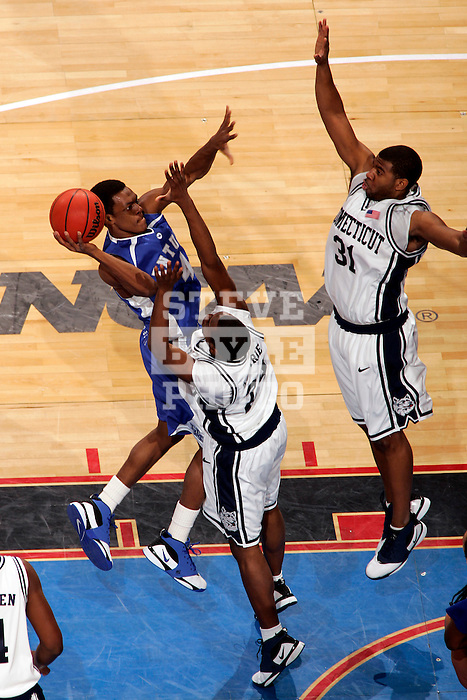 Kentucky guard Rajon Rondo (4) shoots over Connecticut guards Craig Austrie (24) and Rashad Anderson (31).  Connecticut defeated Kentucky 87-83 in the second round of the NCAA Tournament  at the Wachovia Center in Philadelphia, Pennsylvania on March 19, 2006.