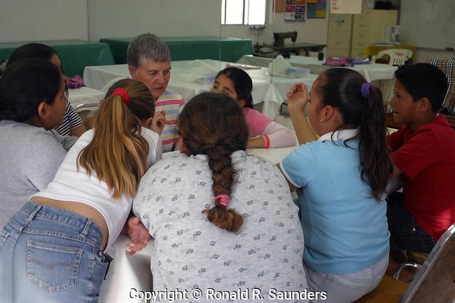 Pupils gather around instructor