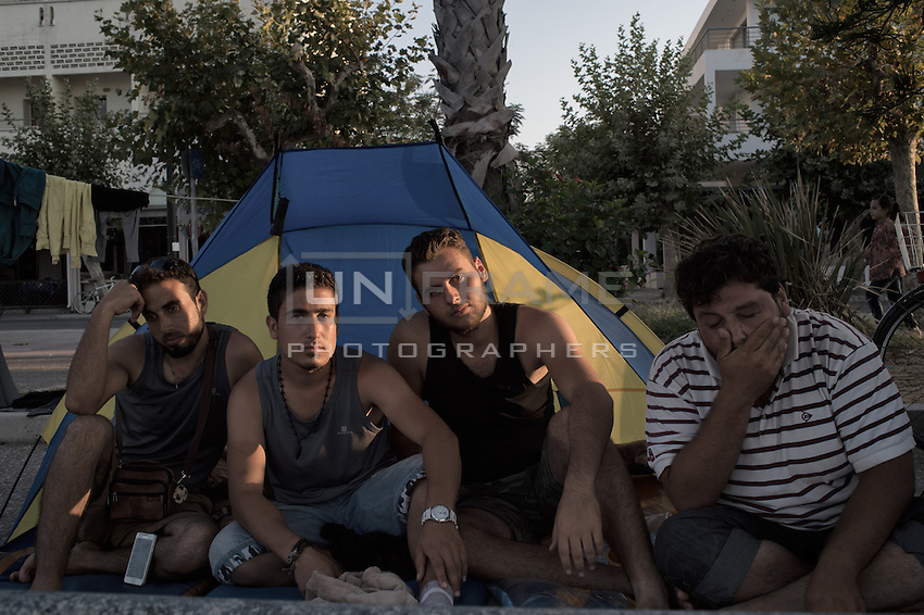 Group of friends from Syria they came together on a small boat on their own and now waiting for the paper from the police to buy ticket to go to Athens. They sleep in the street until then. Kos, Greece. Sept. 05, 2015