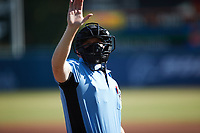 Home plate umpire Jacob McConnell signals to the press box during the game between the Augusta GreenJackets and the Charleston RiverDogs at Joseph P. Riley, Jr. Park on June 27, 2021 in Charleston, South Carolina. (Brian Westerholt/Four Seam Images)