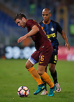 Calcio, Serie A: Roma vs Inter. Roma, stadio Olimpico, 2 ottobre 2016.<br /> Roma's Kevin Strootman, left, is challenged by FC Inter's Joao Mario during the Italian Serie A football match between Roma and FC Inter at Rome's Olympic stadium, 2 October 2016.<br /> UPDATE IMAGES PRESS/Isabella Bonotto