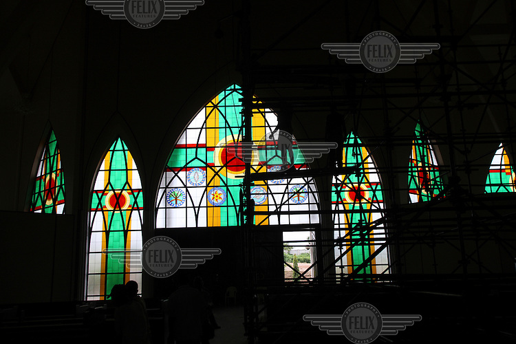 Construction workers inside the National Christian Centre in Abuja.