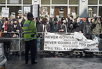 A Metropolitan Police constable stands on duty at an Anonymous protest against the Church of Scientology on April 12, 2008 across from the Dianetics & Scientology Life Improvement Centre on Tottenham Court Road, Camden, London, UK.