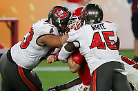 7th February 2021, Tampa Bay, Florida, USA;  Ndamukong Suh (93) and Devin White (45) of the Buccaneers combine to bring down Patrick Mahomes (15) of the Chiefs during the Super Bowl LV game between the Kansas City Chiefs and the Tampa Bay Buccaneers on February 7, 2021 at Raymond James Stadium