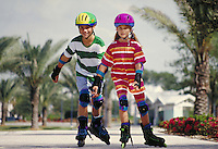 SIBLINGS SKATE TOGETHER. SKATING SIBLINGS. ORLANDO FLORIDA USA.