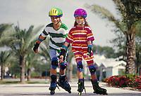 SIBLINGS SKATE TOGETHER. SKATING SIBLINGS. ORLANDO FLORIDA USA.