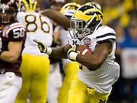 Matthew Cavanaugh of Michigan runs the ball during Sugar Bowl game against Virginia Tech at Mercedes-Benz SuperDome in New Orleans, Louisiana on January 3rd, 2012.  Michigan defeated Virginia Tech, 23-20 in first overtime.