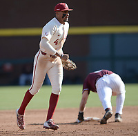 Arkansas second baseman Jalen Battles doubles off UALR third baseman Nathan Lyons Wednesday, April 7, 2021, during the third inning of the Razorbacks' 10-3 win over UALR at Baum-Walker Stadium in Fayetteville. Visit nwaonline.com/210408Daily/ for today's photo gallery. <br /> (NWA Democrat-Gazette/Andy Shupe)